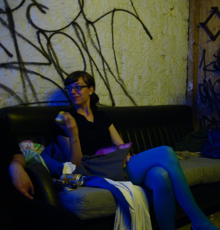Loka on the couch in the castle's prison.
